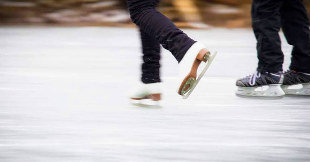 close up of two people ice skating