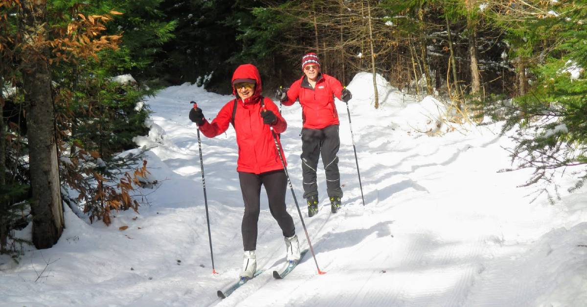 two skiers on trail