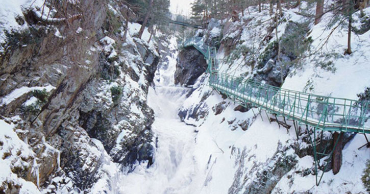 walkway near cliff during winter at high falls gorge
