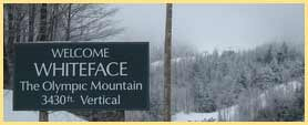 whiteface mountain trail sign in snow