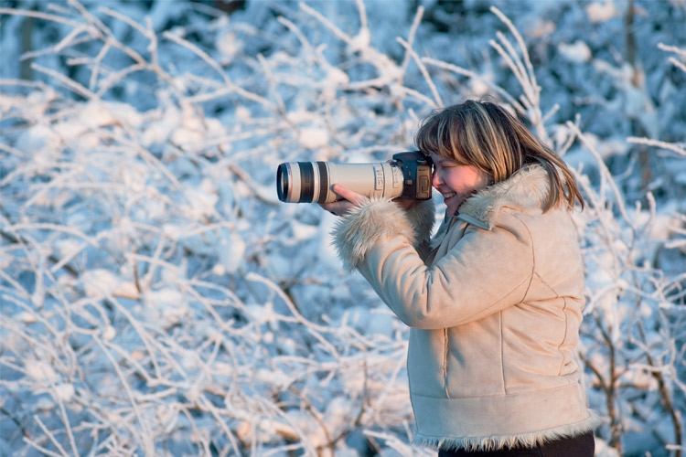 woman taking picture in winter