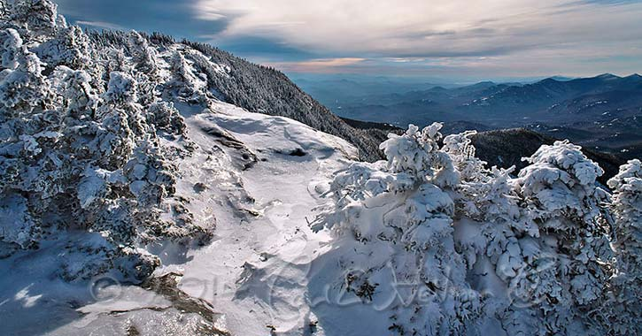 a mountain summit covered in snow