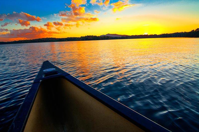 Kyaking at sunset in the St. Regis Canoe Area