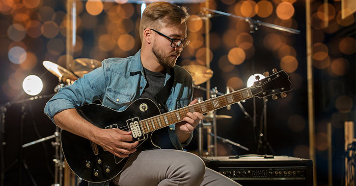 guitarist on stage with equipment
