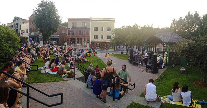 a crowd enjoys a summer concert at berkeley green