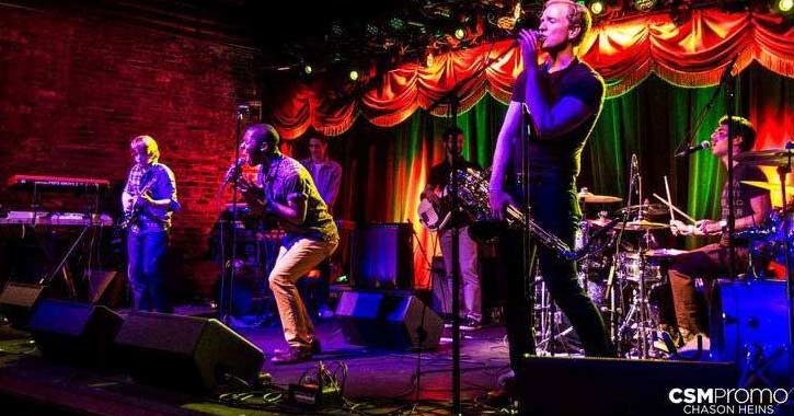 a band performs on stage at smoke signals
