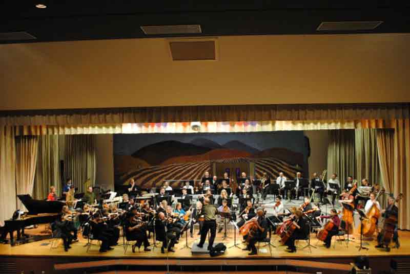 The Orchestra Of Northern New York Plays On Stage In A Rehearsal