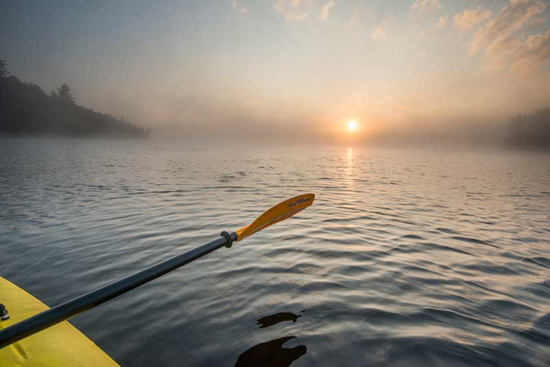 Sunrise on Raquette Lake from a kayak