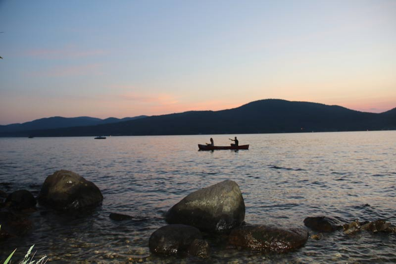 Canoers near Diamond Point on Lake George at dusk