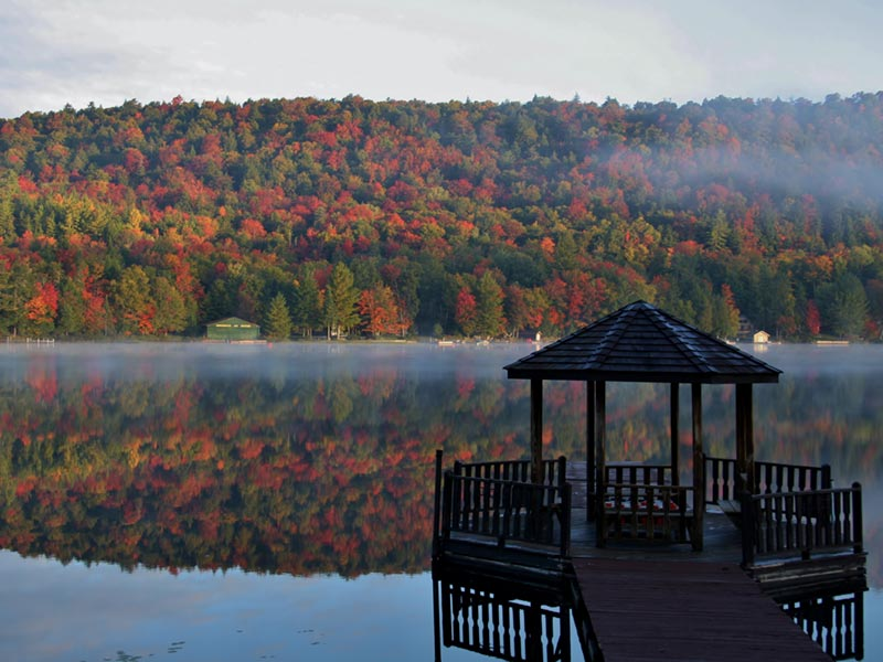 Peak fall foliage as seen from Big Moose Inn's Gazebo Dock
