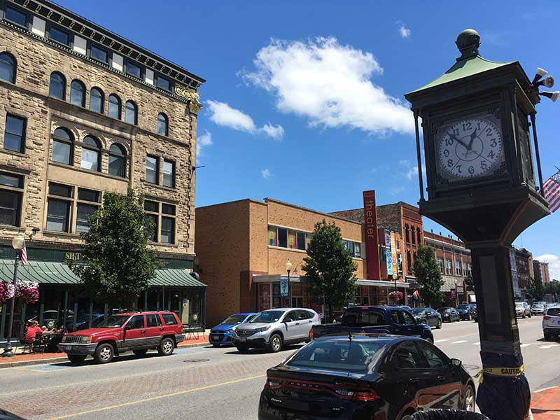 a street in downtown glens falls on a sunny day