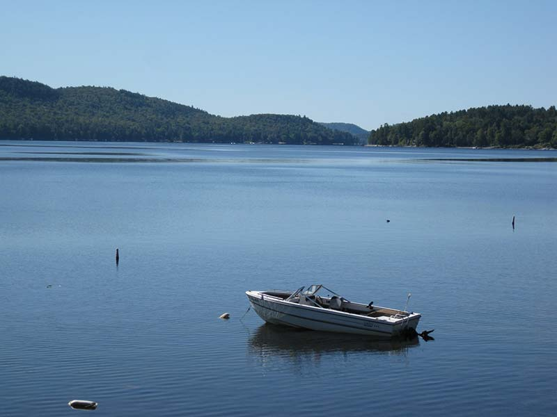A small boat on the water of Schroon Lake in the Adirondacks