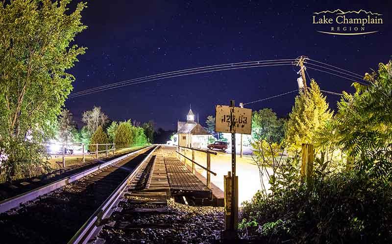 Train tracks at Westport Amtrak Station lit up at night