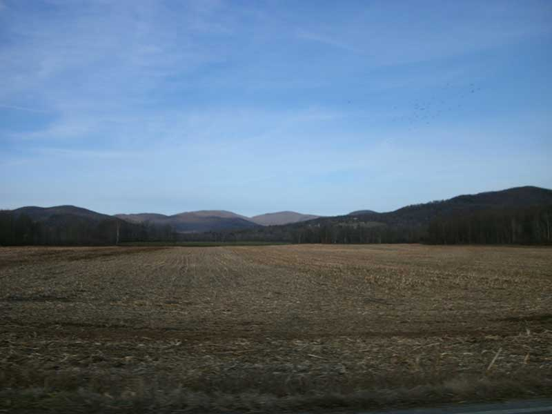 Taconic foothills behind a barren corn filed