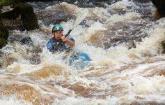 man whitewater kayaking