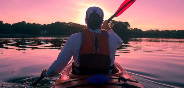 a kayaker on a lake