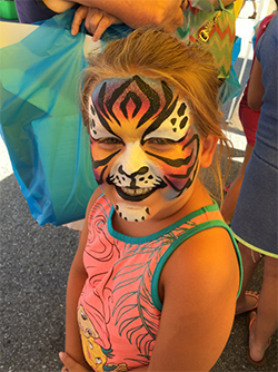 Young girl with a her full face painted