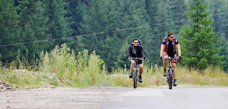 2 men mountain biking