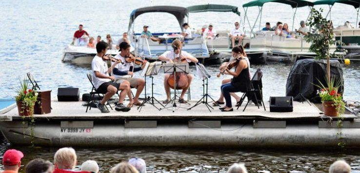musicians playing at the barge