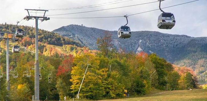 gondola with fall foliage and peaks