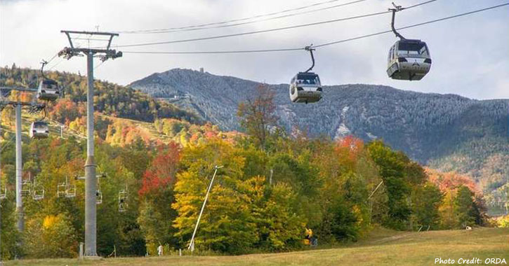 gondola with fall foliage and peaks