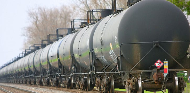 a line of tank cars on a railroad