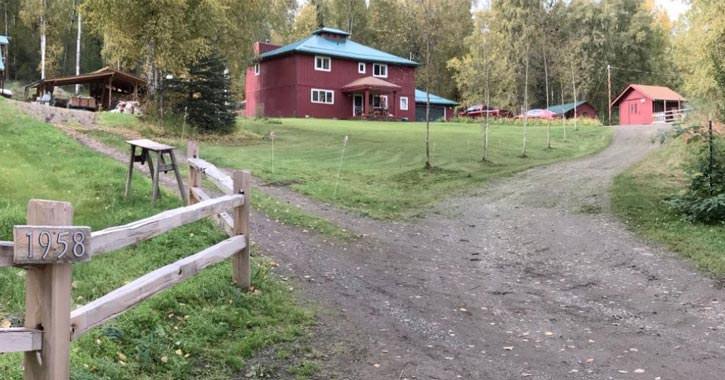 red farm house on a property