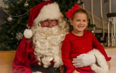 santa claus with girl in red