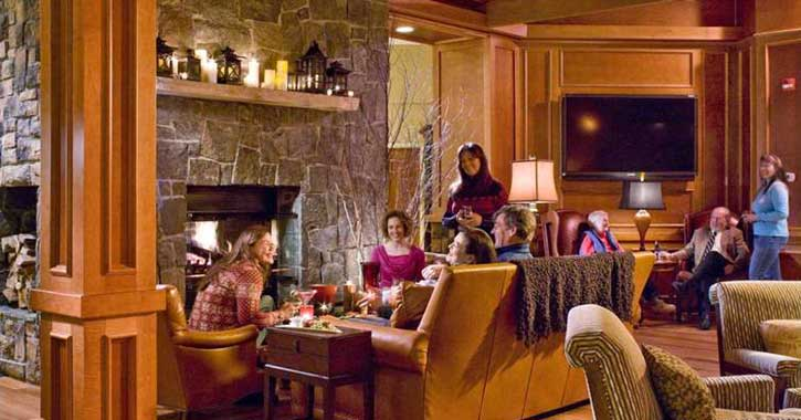 Guests enjoying the fireplace at High Peaks Resort