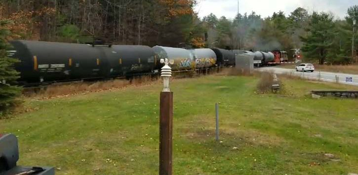 row of tank cars moving