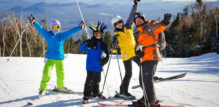 four people on a ski mountain