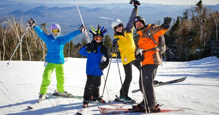 four people on a ski mountain