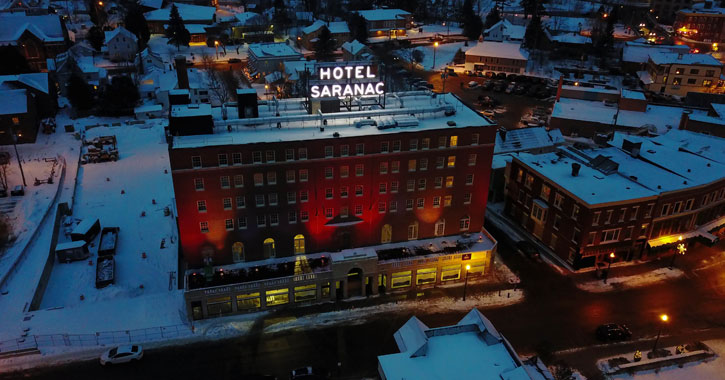 aerial view of Hotel Saranac at night in winter