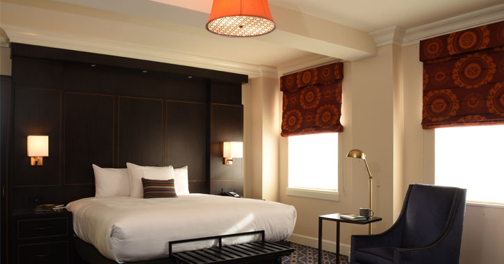 a bedroom in hotel, orange lamp