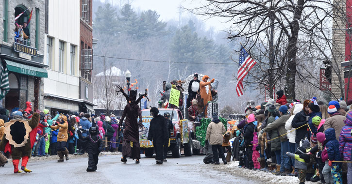 the winter carnival parade with costumed characters