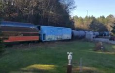 train cars moving down the rail line