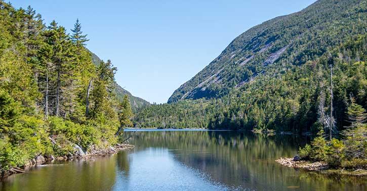 calm water near mountains