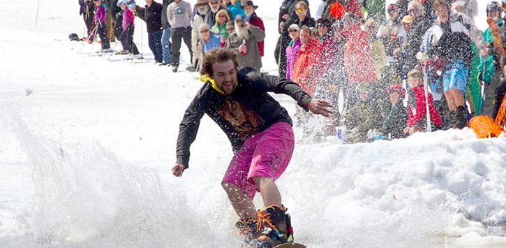pond skimming with a snowboard