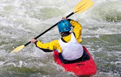 kayaker moving through rapids