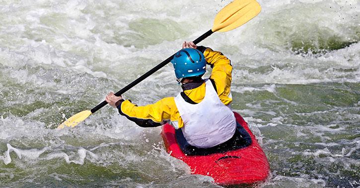 kayaker moving through rapids