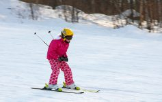 girl downhill skiing