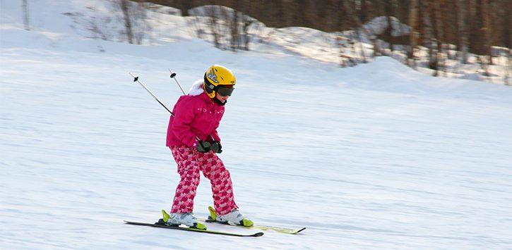 girl downhill skiing