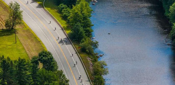 aerial view of bikers near a river