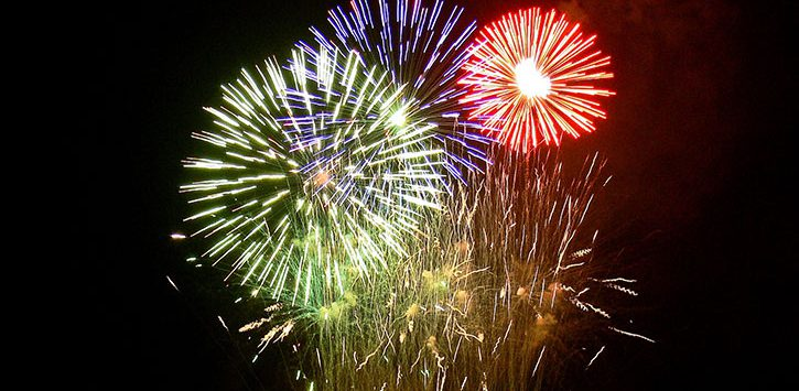 three different colored fireworks