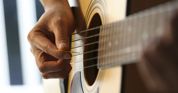 close up of a hand on a guitar