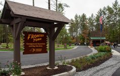 entrance sign of the frontier town campground