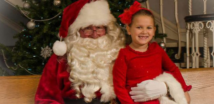 little girl sitting with Santa