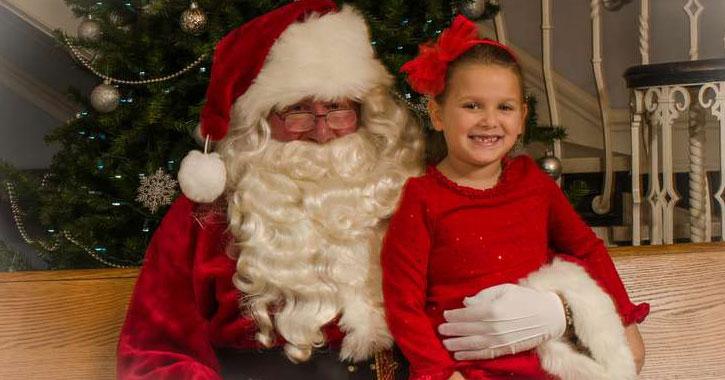 little girl sitting with Santa