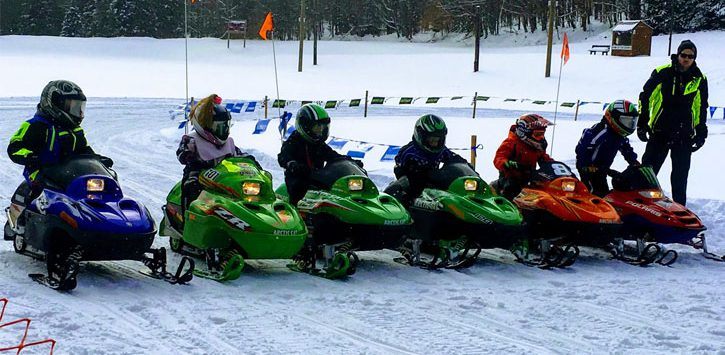 kid snowmobilers lined up to race