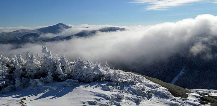 fog over snowy mountain